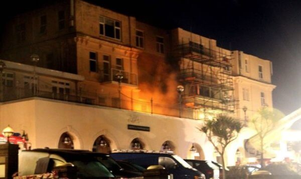 Firefighters work to contain the blaze at the Atlantic Hotel.