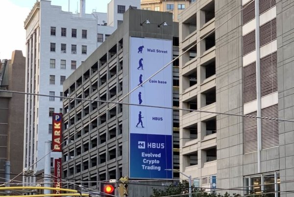 HBUS takes a shot at Coinbase with billboard ad.